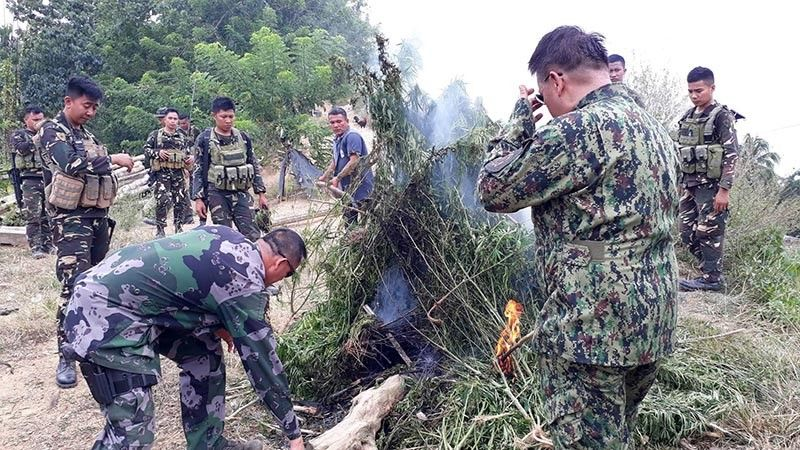 ADIOS, MARY JANE. Police and military personnel burn marijuana plants—also known as Mary Jane, pot, weed and grass, among others—that they uprooted in Sitio Quo, Barangay Gaas, Balamban, Cebu on Tuesday morning, Sept. 24, 2019.  (Sunstar Photo / Arnold Bustamante)