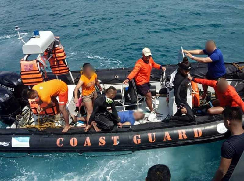 BORACAY. Coast Guard personnel conduct search and rescue operation after a dragon boat team was inundated by sudden big waves on September 25, 2019. Seven of the 21 persons on board drowned after the boat capsized. (Photo from Coast Guard Station Aklan)