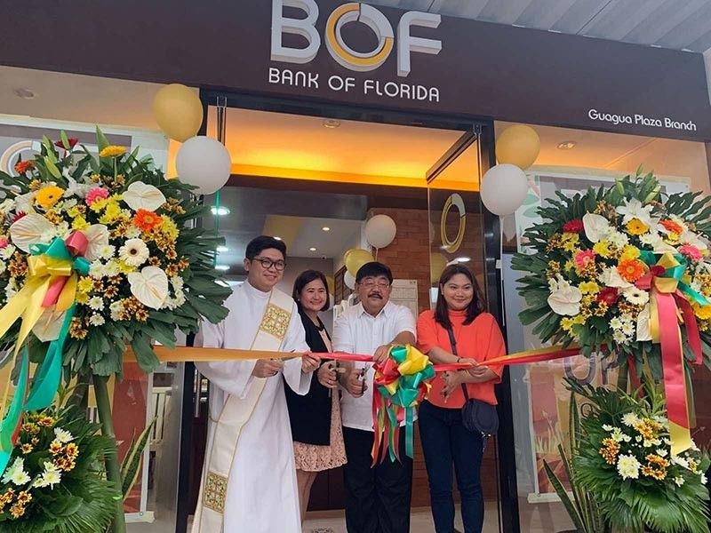 GUAGUA. Bank of Florida (BOF) president Teresa David-Carlos and Guagua Mayor Dante Torres cut the ribbon during the opening of BOF's Guagua branch. Joining them is lawyer Janina Lagman. (Contributed photo)