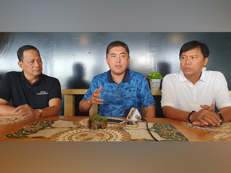 PAMPANGA. Former congressman Arnel Ty (center), president of the San Simon Chamber of Commerce and Industry Inc., and San Simon Mayor Jun Punsalan (right) announced that the local chamber and local government unit are working together for the realization of milestone projects like the new public market, fire trucks, and ambulances. Joining them is SSCCII Corporate Secretary Loret Santos. (Chris Navarro)