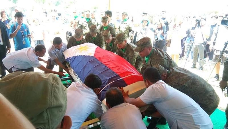 CAGAYAN DE ORO. Family, friends and soldiers bring PMA cadet Darwin Dormitorio to his eternal resting place at the Oro Gardens Memorial Park, Wednesday. Dormitorio's kin will continue to seek justice until it is served. (Photo by Menzie Montes)