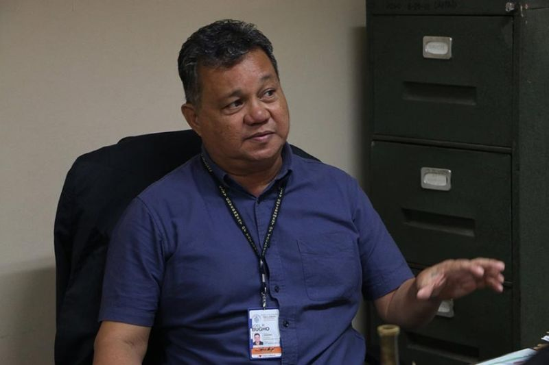 TACLOBAN. Joel Bugho, officer-in-charge of the market operations. (Photo courtesy of C. Merin/D. Abarquez/Tacloban City Information Office)