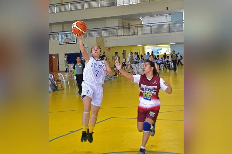LADY BLUE KNIGHT. Ma. Isabel Torrecampo of the Ateneo de Davao University Lady Blue Knights, left, shoots against a Philippine Women's College Lady Patriots defender in their college women's basketball semifinals match at the Addu Jacinto gym yesterday. (Macky Lim)