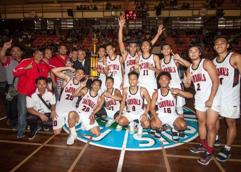 BAGUIO. University of Baguio Cardinals, in this 2018 file photo, receives the men's basketball trophy after flexing their muscle in two games against the Saint Louis University Navigators in the Baguio – Benguet Educational Athletic League (BBEAL). BBEAL formally opens October 4 with Cordillera Career Development College as host. (Photo by Jean Nicole Cortes)