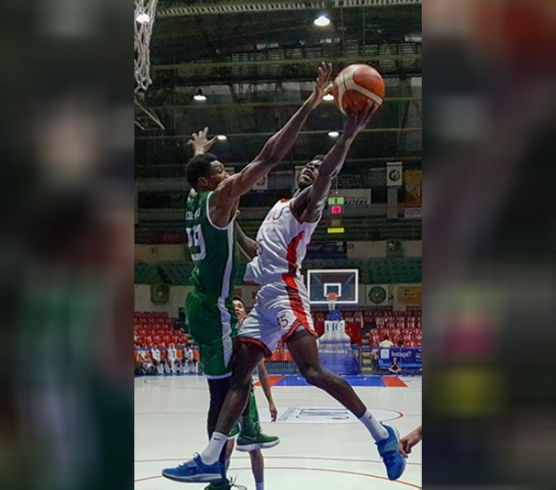 University of the Visayas (UV)'s Lass Coulibally blocks the shot of SWU-Phinma's Lamine Thiam. Coulibally and the rest of the Green Lancer squad would eventually end SWU-Phinma's three-game winning streak during Thursday night's Cesafi men's basketball tournament. (SunStar photo/ Arni Aclao)
