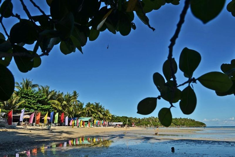PARADISE NOT LOST. Local and foreign tourists seek respite in Camotes Island, which has several tourist attractions, including Santiago Bay Beach Resort (in photo) in San Francisco town and other beaches, lakes and underground caves. Rep. Vincent Franco Frasco has filed a bill seeking to lift the mangrove reserve declaration for Camotes's three islands—Poro, Pacijan and Ponson—to open these places for development. (SunStar photo / Amper Campaña)
