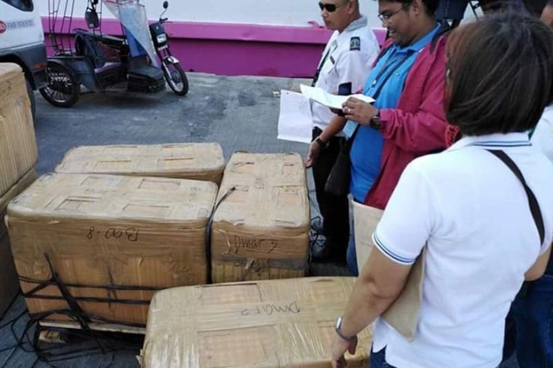 BACOLOD. Members of the Provincial Task Force on African Swine Fever, along with personnel of the Bureau of Animal Industry and Philippine Coastguard, seized about 777 kilograms of assorted pork products at the Bredco Port in Bacolod City on Wednesday, September 25, 2019. (Contributed Photo)