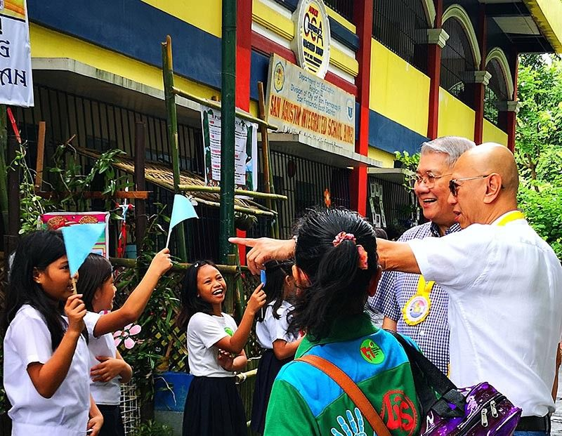 PAMPANGA. Students of San Agustin Integrated School-Annex are all smiles as they welcome San Fernando Vice Mayor Jimmy Lazatin (R) and Tony De Leon (2nd, R), Senior Vice President of San Fernando Electric Light and Power Company during the turnover of a two-story, four-classroom school building last September 17, 2019. (Contributed photo)