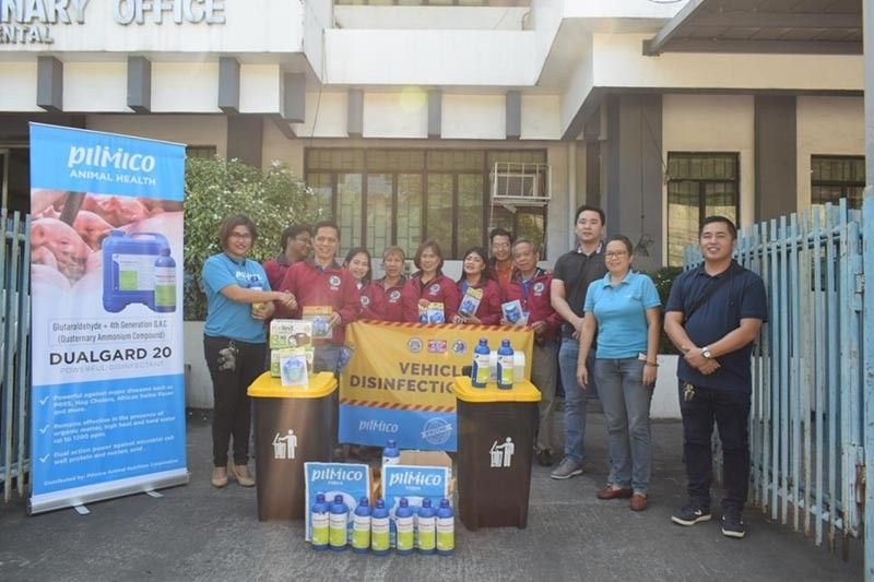 BACOLOD. Provincial Veterinary Office (PVO) personnel led by Provincial Veterinarian Renante Decena (second from left) receive materials and equipment from various animal feed and drug suppliers in the province at the PVO grounds in Bacolod City recently. (Contributed photo)