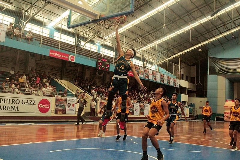 DAVAO. A Rizal Memorial Colleges (RMC) Bulldogs shooters scores on a lay-up during a game against Davao Jones Academy at the start of the RMC Davao's Pride Basketball League (DPBL) Season 3 at the RMC Petro Gazz Arena recently. (Photo by DPBL)