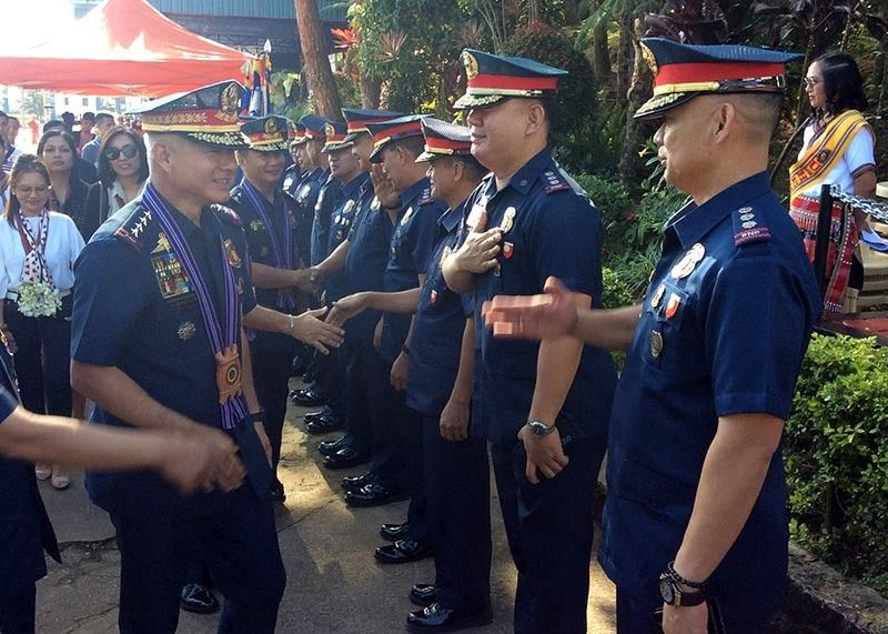 BAGUIO. Philippine National Police Director General Oscar Albayalde is welcomed by Police Regional Office Cordillera-Cordillera Director Israel Ephraim Dickson during the 118 Police Service Anniversary at Camp Bado Dangwa in La Trinidad, Benguet. (Jonathan LLanes)