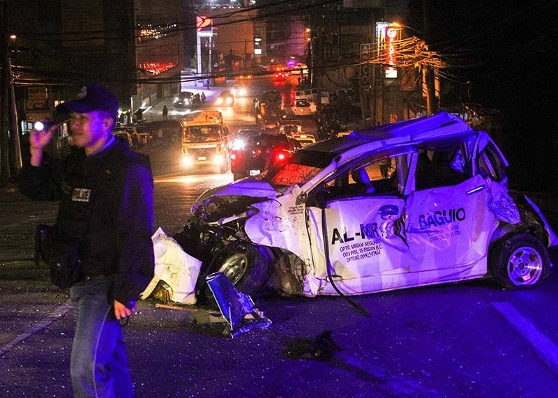 BAGUIO. A police officer directs traffic along Buhagan (Bokawkan) Road after a 10-wheeler truck lost its brakes, hitting 16 vehicles and killing a motorcycle rider. (Jean Nicole Cortes)