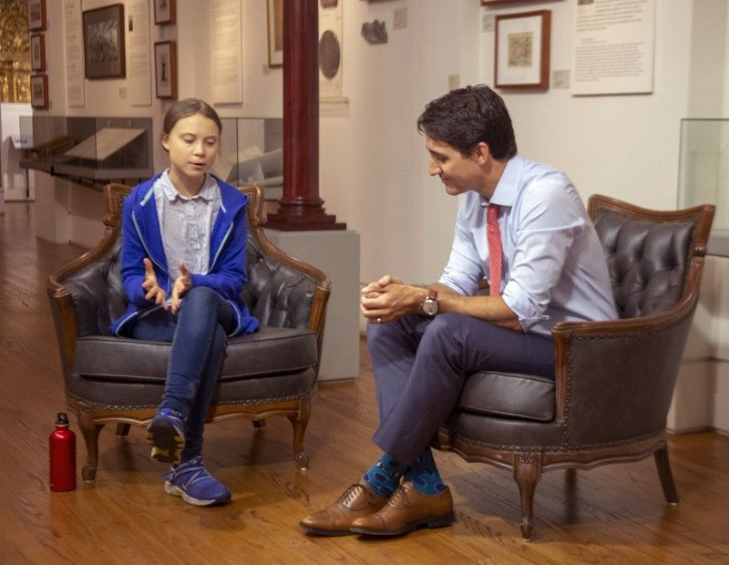 CANADA. Canadian Prime Minister Justin Trudeau speaks Swedish environmental activist Greta Thunberg in Montreal on Friday, Sept. 27, 2019. Thunberg says she delivered the same message to Trudeau that she gives to all politicians - that he needs to listen to the science and act on it. (AP)