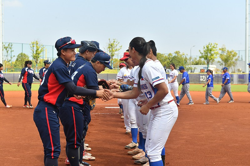 NICE GAME. The Blu Girls (right) and their Chinese Taipei counterparts shake hands after their semifinal game. (Contributed Photo)