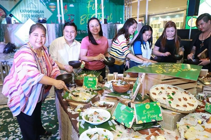 ANGELES CITY. Angeles City Vice Mayor Vicky Vega-Cabigting, SM City Clark Mall Manager Andrea Madlangbayan, City Legal Officer Ralph Macalino, DOT reresentative Chriselle Yambao, and HARP President Fatima Orfinada sample Kapampangan cuisine during Friday's opening of the Pampanga Food BESTival which will run from September 27 to October 10 at SM City Clark. (Photo by: Chris Navarro)