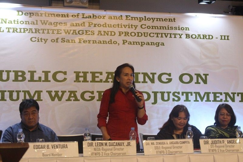 CITY OF SAN FERNANDO. Dole-3 Director Zenaida Angara-Campita discusses salient points on wages during the hearing on September 20 at The Orchid Gardens in the City of San Fernando. (Contributed photo)