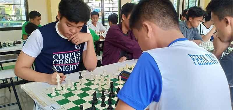 CAGAYAN DE ORO. Corpus Christi's David Rey Ancheta writes down his move on Friday's blitz chess competition of the 2019 City Division Meet at City High National High School building in Cagayan de Oro City. (Lynde Salgados)