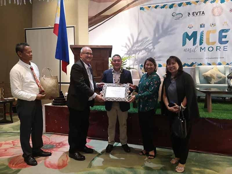 "LEYTE. Reynaldo ""Pocholo"" Franco (second from left), president of Eastern Visayas Tourism Association (Evta) and Department of Tourism (DOT) regional director Karen Tiopes (second from right) present the certificate of appreciation to DOT Undersecretary Arturo Boncato Jr. (center) during the first anniversary celebration of Evta on September 28, 2019 at the Oriental Leyte in Palo. (Photo courtesy of Rhoel Ladera)"