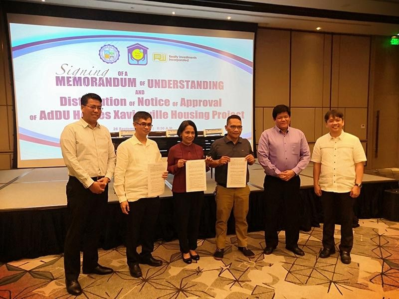 MOU INKED. Representatives from Pag-Ibig Fund, Ateneo de Davao University, and Realty Investments Inc during the Tripartite Memorandum of Understanding signing for the Ateneo de Davao University's employees housing project on Thursday, September 26 at the dusitD2 Hotel, Davao City. (Ace Perez)