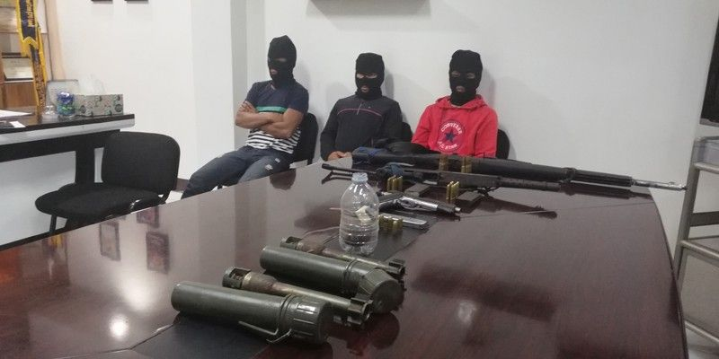CAGAYAN DE ORO. The Cagayan de Oro City Police Office presents three suspected NPA rebels who surrendered in Barangay Tignapoloan, Cagayan de Oro City, on September 24. (PJ Orias)