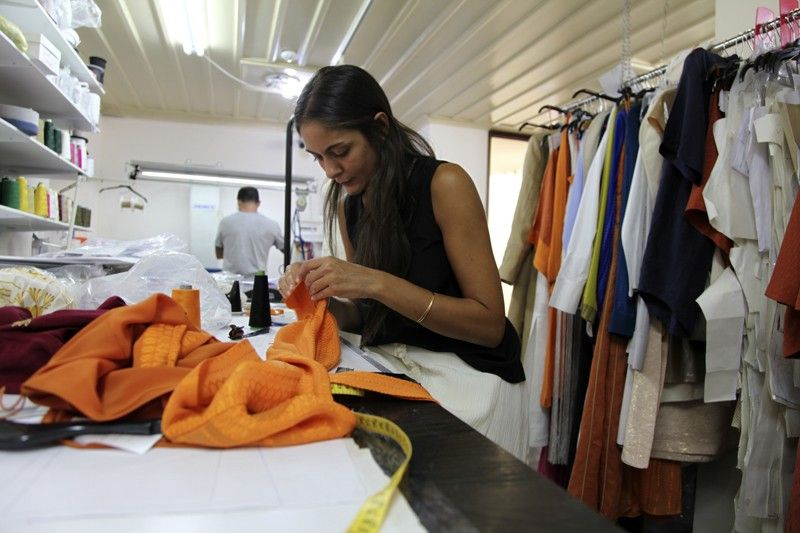 ATHENS. In this Wednesday, September 4, 2019 photo designer Lydia Vousvouni of fashion firm Zeus Dione works at the firms' atelier in Athens. Greece's financial crisis nearly snuffed out the country's centuries-old silk manufacturing tradition, but the end of the crippling recession has raised demand for fashion products and silk produced by a remote border town. (AP)