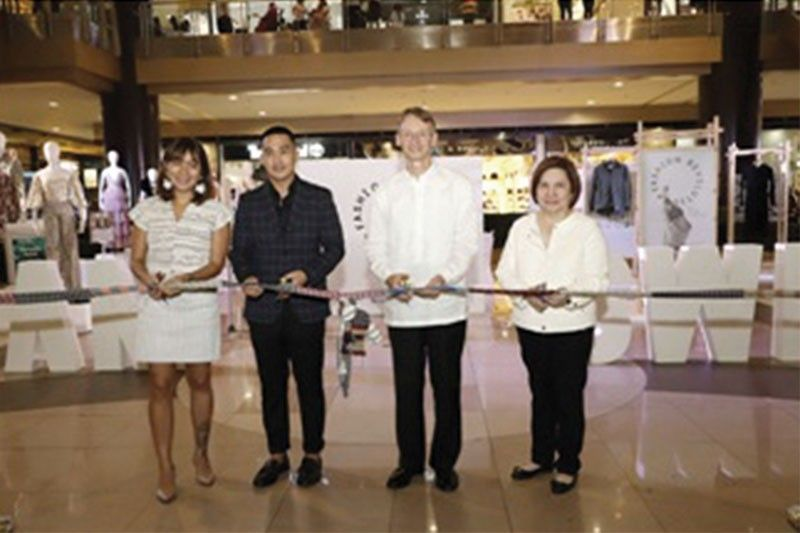 RIBBON CUTTING. Left, Anya Lim of Anthill Fabric Gallery, H&M Philippines head of communications Dan Mejia, Swedish Ambassador Harald Fries and SM Prime Holdings Inc. vice president Marissa Fernan