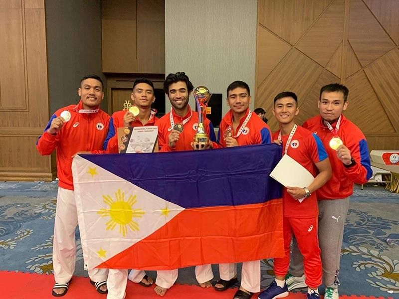DAVAO. The Philippines senior men's kumite team members, including Davao City's Rexor Romaquin Tacay (fourth from left), pose with their gold medals and champion's trophy at the close of the Turkish Open Grand Prix Karate in Istanbul, Turkey Sunday, September 29 (Philippine time). (Miyuki Tacay photo)