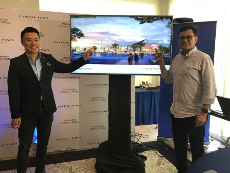 MEGAWORLD MALL. Kevin Andrew L Tan, Chief Strategy Officer of Megaworld Corporation and Architect Dave Rivera of RDES Consultants Incorporated show the proposed P1.8 billion mall which will be constructed at the Capital Town in the City of San Fernando. (Photo by Reynaldo G. Navales)
