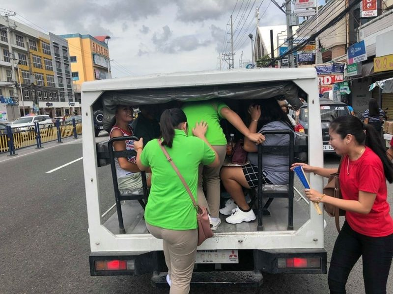 Passengers stranded at the intersection along the Jose Abad Santos Avenue in the City of San Fernando, Pampanga board a police patrol car after local government units and the Philippine National Police PNP provided free rides during yesterday's Nationwide transport strike.