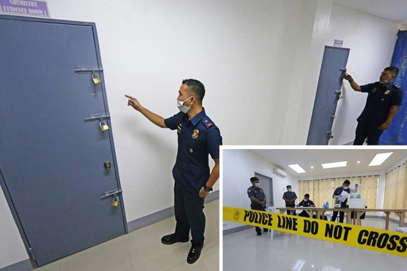 PADLOCKED, SAFE. Members of the Crime Laboratory show the two evidence rooms that are padlocked heavily (above), making them difficult to breach. They conduct an open inventory of the seized drugs in their custody (inset) Monday, Sept. 30, 2019, in the spirit of transparency in handling seized drugs.  (Photos by Alan Tangcawan)