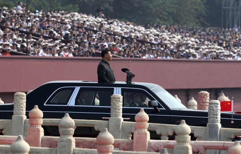 BEIJING. Chinese leader Xi Jinping rides in an open-top limousine during a parade to mark the 70th anniversary of the founding of Communist China in Beijing, Tuesday, October 1, 2019. (AP)