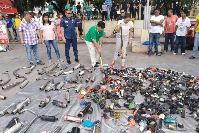 PAMPANGA. Guagua Mayor Dante Torres led the destruction of illegal mufflers and flashing devices as he reiterated his warning against illegal modification of motorcycles. (Photo by Ian Ocampo Flora)