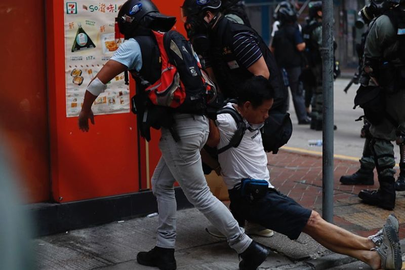 HONG KONG. An injured anti-government protester is attended to by others during a clash with police in Hong Kong, Tuesday, Oct. 1, 2019. Thousands of black-clad protesters marched in central Hong Kong as part of multiple pro-democracy rallies Tuesday urging China's Communist Party to