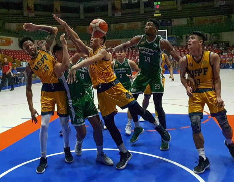 Players from University of the Visayas (UV) and University of Southern Philippines Foundation (USPF) go for the loose ball during their heated clash on Tuesday night. (SunStar foto/Arni Aclao)