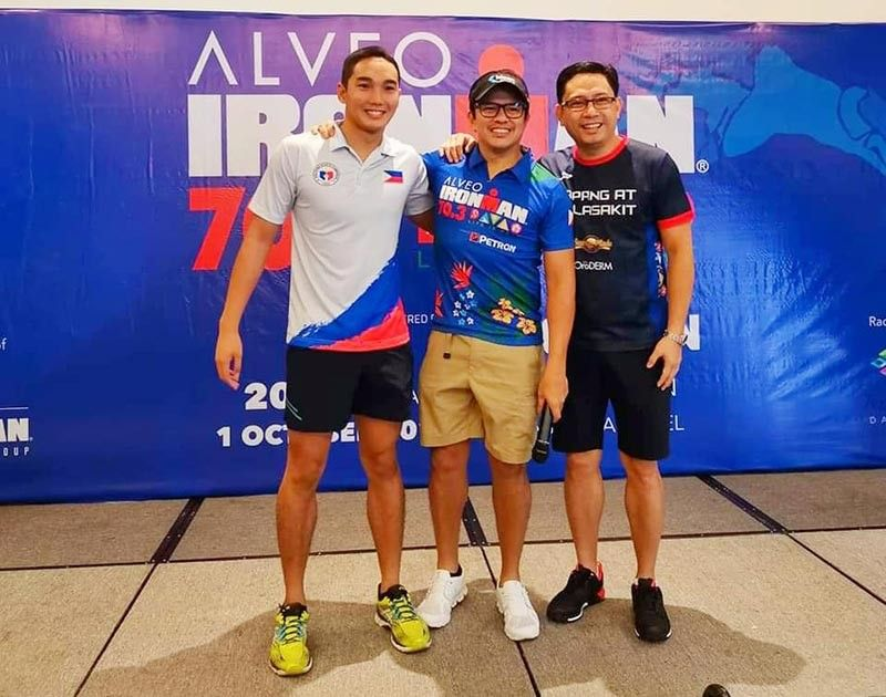 DAVAO. The Tapang at Malasakit relay team of swimmer Juan Antonio Mendoza (left), cyclist Mikey Aportadera and runner lawyer Mans Carpio were among the early birds of the third Alveo Ironman 70.3 Davao registration at Seda Hotel in Davao City Tuesday, October 1, 2019. (Photo from Mikey Aportadera's Facebook page)