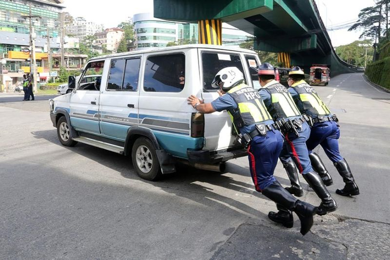 BAGUIO. Personnel of the Highway Patrol Group (HPG)-Cordillera who were assisting the Baguio police in managing traffic flow on the day of the national transport strike chanced upon a vehicle driven by an old man. (Contributed photo)