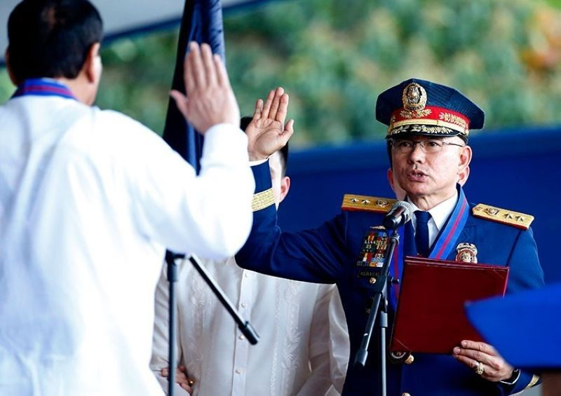 MANILA, In this file photo, Philippine National Police (PNP) Chief Oscar Albayalde takes his oath of office before President Rodrigo Duterte. (File Photo)