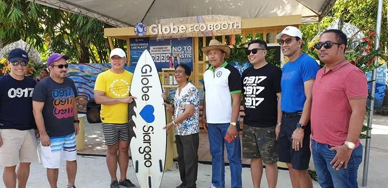 DIGITAL, SUSTAINABLE TOURISM. Globe president and chief executive officer Ernest Cu (third from left) leads the launching of the Globe Eco Booth in Siargao Island. Globe and the Department of Tourism are working together to promote sustainable tourism practices through a video that also celebrates the beauty and uniqueness of the Filipinos and the Philippines. (Contributed photo)