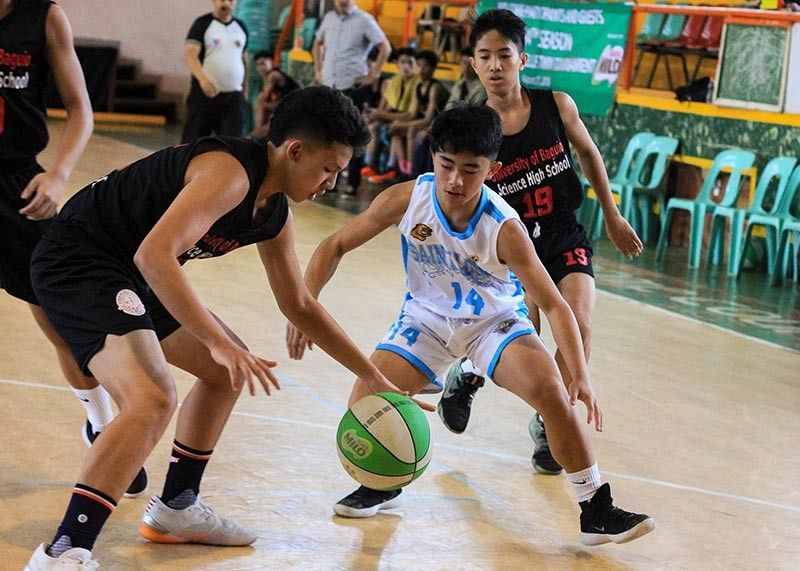 PLAYING DEFENSE. Aaron Velarde of SLU – LHS plays tough defense against a UB Science High dribbler in the ongoing Baguio leg of the Milo Best twin tournament. (Photo courtesy of Best Center Sports Baguio)