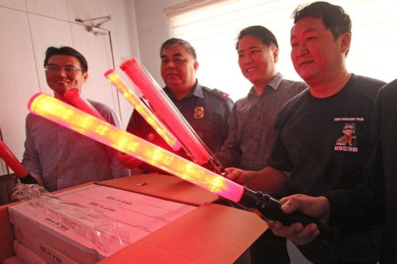 JEDI COPS: The Government of South Korea and a group of Korean businessmen donate 300 reflectorized batons that look like lightsabers of Jedis to the Police Regional Office (PRO) 7 on Wednesday, Oct. 2, 2019. Aside from being reflectorized, the batons also have a flashlight feature, making them useful at night. Of the 300, 100 will go to the police force of Lapu-Lapu City, where there is a big population of South Koreans. The South Koreans also donated 33 motorcycles to PRO 7 (represented here by Brig. Gen. Debold Sinas, second from left). They promised to give modern firearms to the PRO 7. (Contributed photo / Arnold Y. Bustamante)