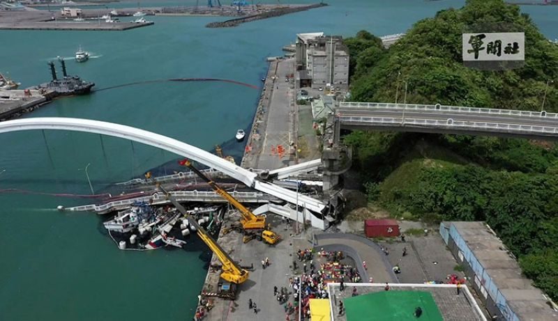 TAIWAN. This image made from video provided by Taiwan's Military News Agency shows Nanfangao Bridge, collapsed in Nanfangao, eastern Taiwan, Tuesday, October 1, 2019. (Taiwan's Military News Agency via AP)