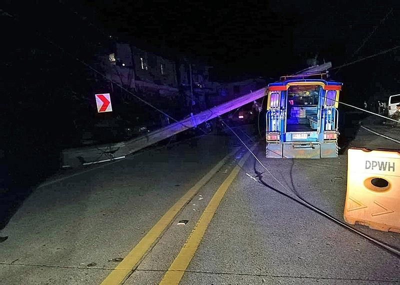 BAGUIO. A passenger jeepney got tangled with power lines after a landslide in Badiwan, Tuba, Benguet, injuring two passengers. (Photo courtesy of Tuba police)