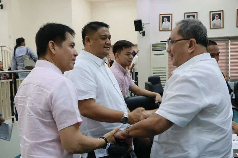 PAMPANGA. City Councilors Jay Sangil and Alfie Bonifacio shake hand with Angeles City Water District general manager Reynaldo Liwanag during a recent committee hearing at the City Council. (Reynaldo G. Navales)