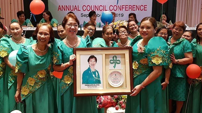 DAVAO. Davao Girl Scout Council executive Teresita D. Pia (left side, holding the frame) retires after 45 years of loyal service. Presenting her token is Mallet T. Arobo, regional executive director of the GSP Eastern Mindanao Region (right). (Janette Huang Teves)