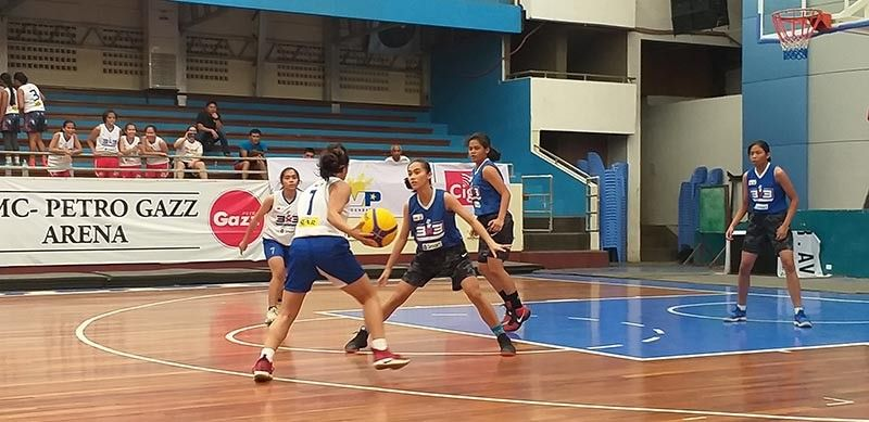 Daniel R. Aguinaldo National High School (Dranhs) players, wearing blue jerseys, put up tight defense against Ateneo de Davao University Lady Blue Knights during SBP 3X3 regional eliminations at RMC Petro Gazz Arena in Davao City Saturday, October 5, 2019. (Marianne L. Saberon-Abalayan)