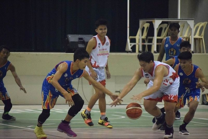 Players from Bohol Wisdom School and Cristal e-College pursue the loose ball in their game in the BSAA. (Contributed photo)