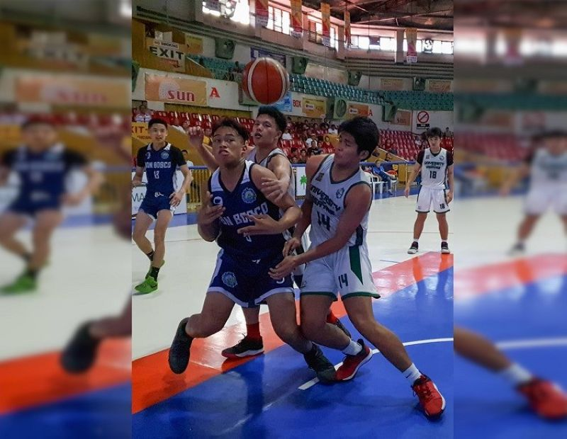 Players from Don Bosco and UV clash in their pursuit of the loose ball. (Photo by Arni Aclao)