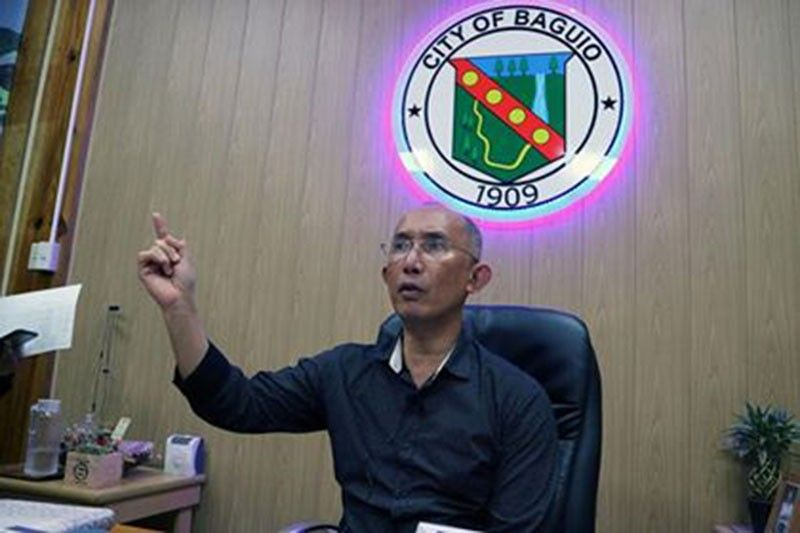 BAGUIO. Baguio City Mayor Benjamin Magalong gestures as he stresses a point during a press briefing at the Baguio City Hall on Friday, October 4, 2019. Magalong clarified that security measures were beefed up partly as a result of his appearance before the Senate investigation into corruption among the police and at the New Bilibid Prison. (Photo by Redjie Melvic Cawis)