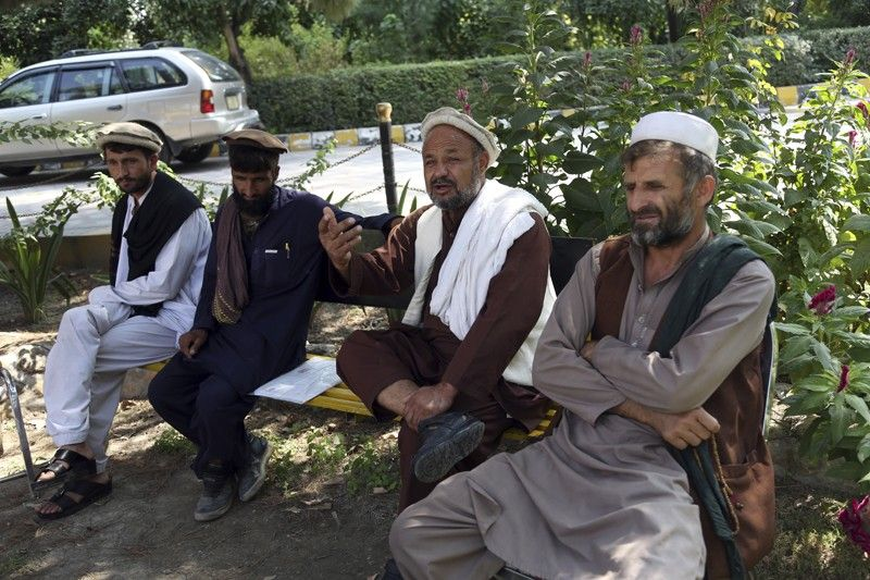 AFGHANISTAN. In this Tuesday, October 1, 2019, photo, Aziz Rahman, second, right, a village elder, who had contracted the farmers to harvest the pine nuts, speaks during an interview to the Associated Press in Jalalabad city east of Kabul, Afghanistan, Anger is mounting over the increasing numbers of civilians dying in misdirected U.S. aerial strikes and heavy-handed tactics of CIA-trained Afghan force. Some Afghans calling for Americans to be tried in Afghan courts (AP)