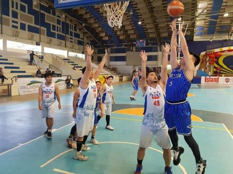 Wynne Yap of Batch 2004 attempts a shot in their game against Batch 2006. (Contributed photo)